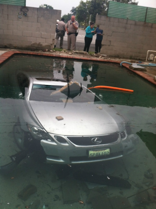 Local police take photos of the submerged Lexus. (Beatriz Diaz/ABC 7)