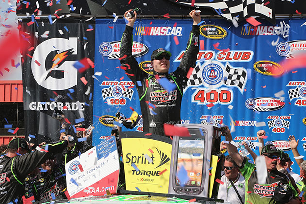 Kyle Busch celebrates victory after winning the NASCAR Sprint Cup Series Auto Club 400. (Jerry Markland/Getty)