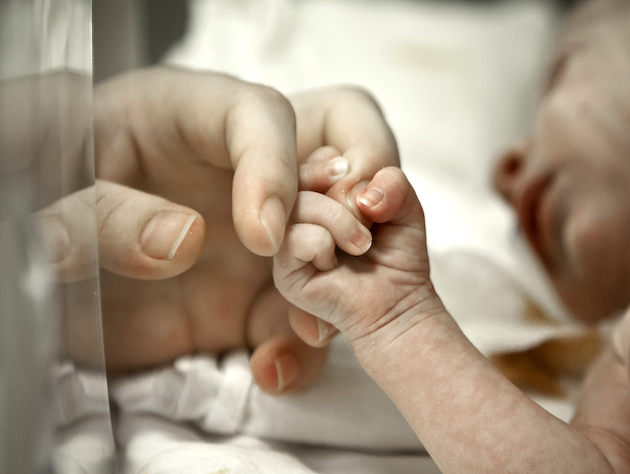 http://media.zenfs.com/en/blogs/thesideshow/newborn.jpg