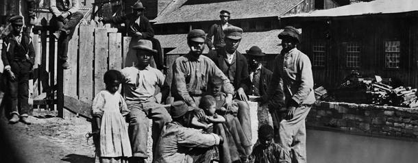 ca. 1860's, USA. Freed slaves in Southern town shortly after the Civil War. © Bettmann/CORBIS
