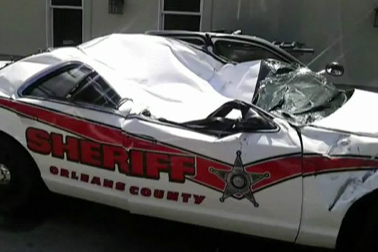 One of five crushed Newport, Vt., police cruisers (WCAX)
