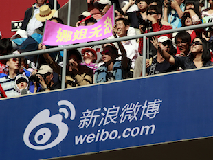 An advertisement for China's most popular micro blogging site ( (AP/Ng Han Guan)