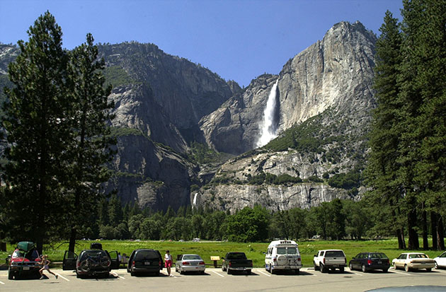 Cars fill a parking lot near Yosemite Falls (David McNew/Getty)