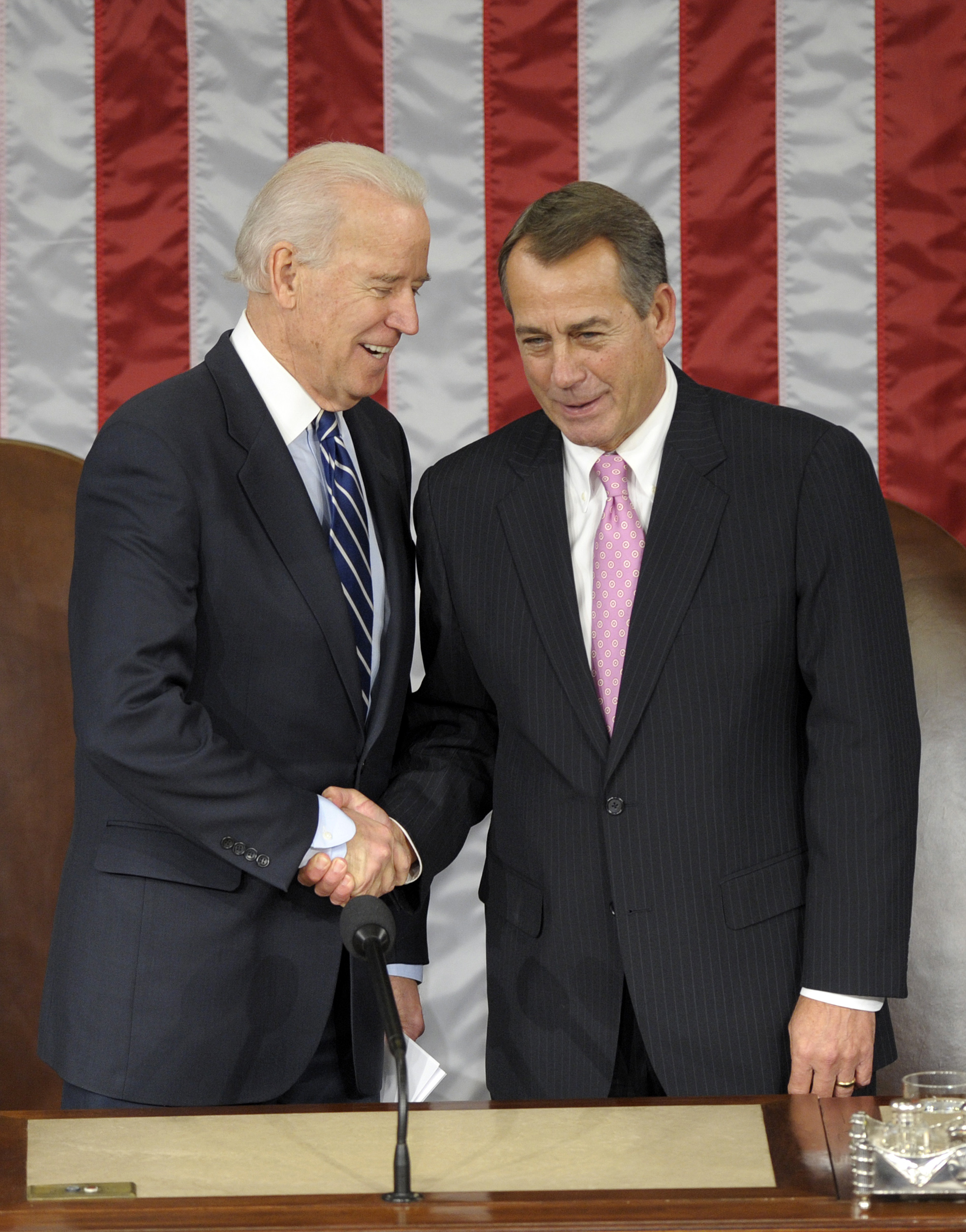 Vice President Joe Biden shakes hands with House Speaker John Boehner of Ohio in the House Chamber before the counting of Electoral College votes on Capitol Hill on Friday. (Susan Walsh/AP)