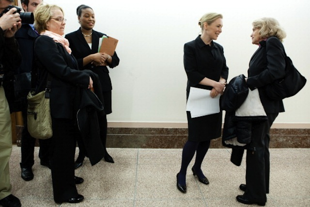 Sen. Kirsten Gillibrand (D-NY) talks with Edith Windsor (R) in the hallway before a news conference on gay marriage. (Brendan Hoffman/Getty)