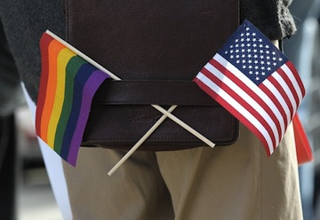 A gay pride and an American flag hang from a shoulder bag during a gay rights demonstration. (Justin Sullivan/Getty Images)