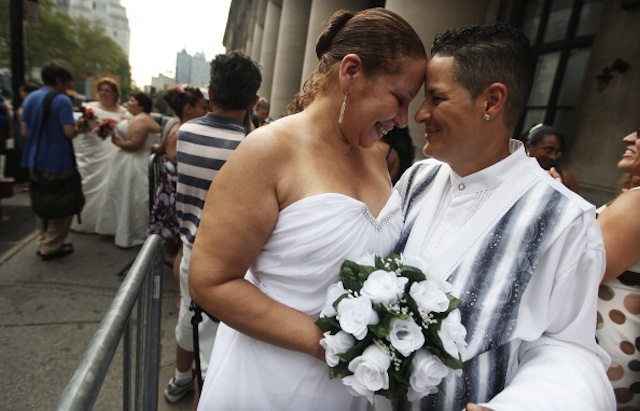 Maira Garcia (R) and Maria Vargas wait to get married at the Brooklyn City Clerk's office on July 24, 2011 in New York City. (Mario Tama/Getty)