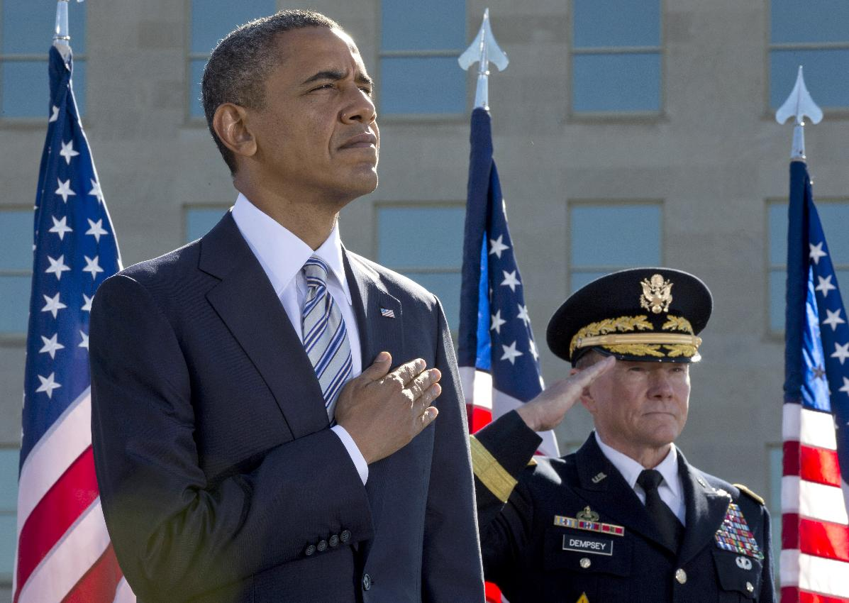President Barack Obama and Joint Chiefs Chairman Gen. Martin Dempsey participate in a 9/11 ceremony at the Pentagon Memorial. (Carolyn Kaster/AP)