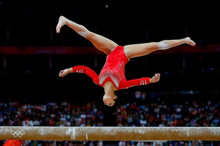 Team USA's Alexandra Raisman competes on the balance beam in the Artistic Gymnastics Women's Team final on Tuesday (Jamie Squire/Getty Images)