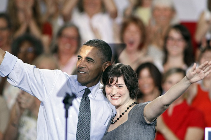 Sandra Fluke gets a hug from U.S. President Barack Obama after introducing him in Denver. ( Marc Piscotty/Getty Images)