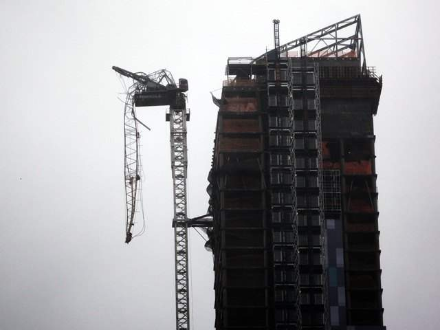 The damaged crane, part of construction on the One57 building, on West 57th Street (Allison Joyce/Getty Images)