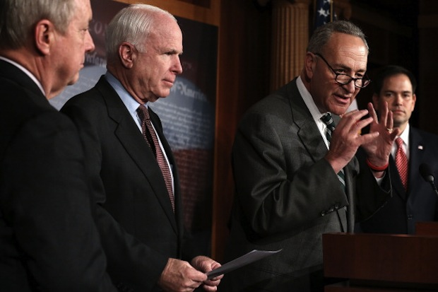 U.S. Sen. Charles Schumer (D-NY) speaks as Senate Majority Whip Sen. Richard Durbin (D-IL), Sen. John McCain (R-AZ) and Sen. Marco Rubio (R-FL) listen during a news conference on immigration. (Alex Wong/Getty Images)