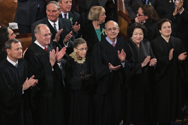 Supreme Court justices applaud at the State of the Union last month. (Three justices did not attend.) (Chip Somodevilla/Getty Images)