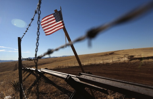 An American flag flies at the U.S.-Mexico border near Sonoita, Ariz., in February. (John Moore/Getty Images)