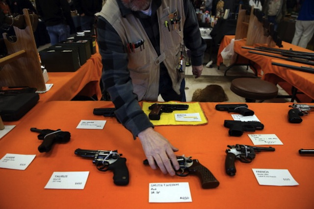 Bob Pfefferkorn sells handguns at the Gun, Knife and Outdoorsmen Show in Fort Wayne, Indiana, on Feb. 9, 2013. (Brian Cassella/Chicago Tribune/MCT via Getty Images)