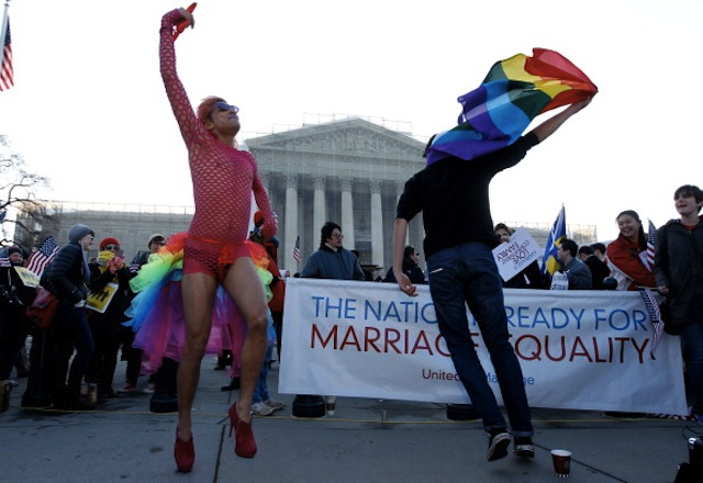 Qween Amar of Orlando, Fla., left, dances as demonstrators gather outside the U.S. Supreme Court in Washington. (Molly Riley/MCT via Getty)