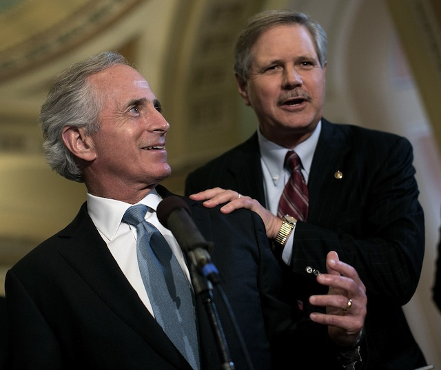 Tennessee Republican Sen. Bob Corker (l) and North Dakota Sen. John Hoeven (r). (Win McNamee/Getty Images)