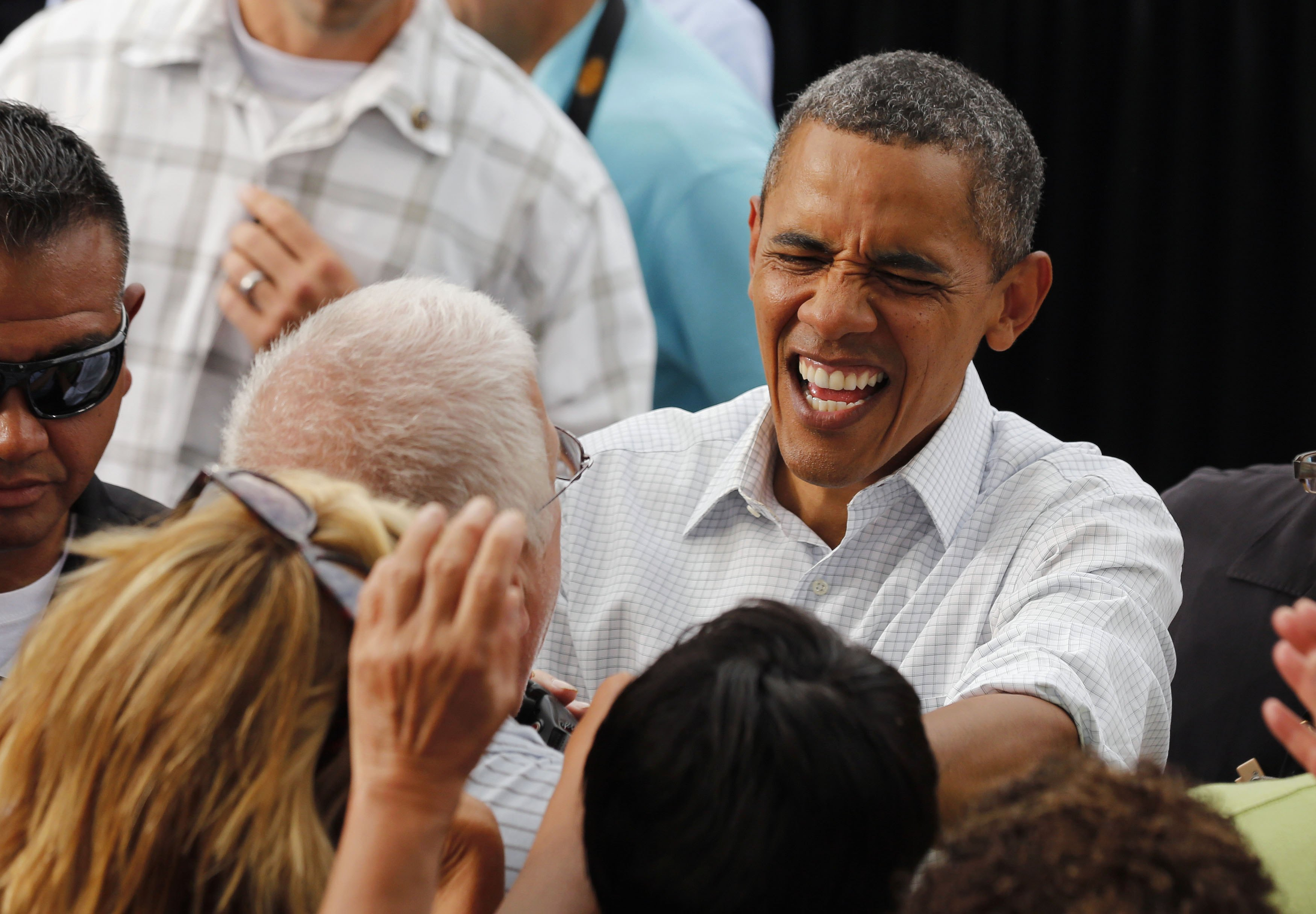 President Barack Obama greets audience members at a campaign event in Iowa (Larry Downing/Reuters)