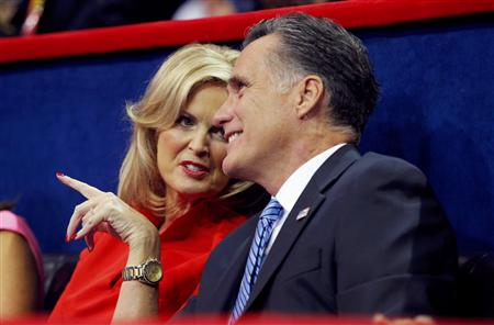 Republican presidential nominee Mitt Romney talks with his wife Ann as they listen to New Jersey Governor Chris Christie deliver the keynote address during the second session of the 2012 Republican National Convention (Brian Snyder/Reuters)