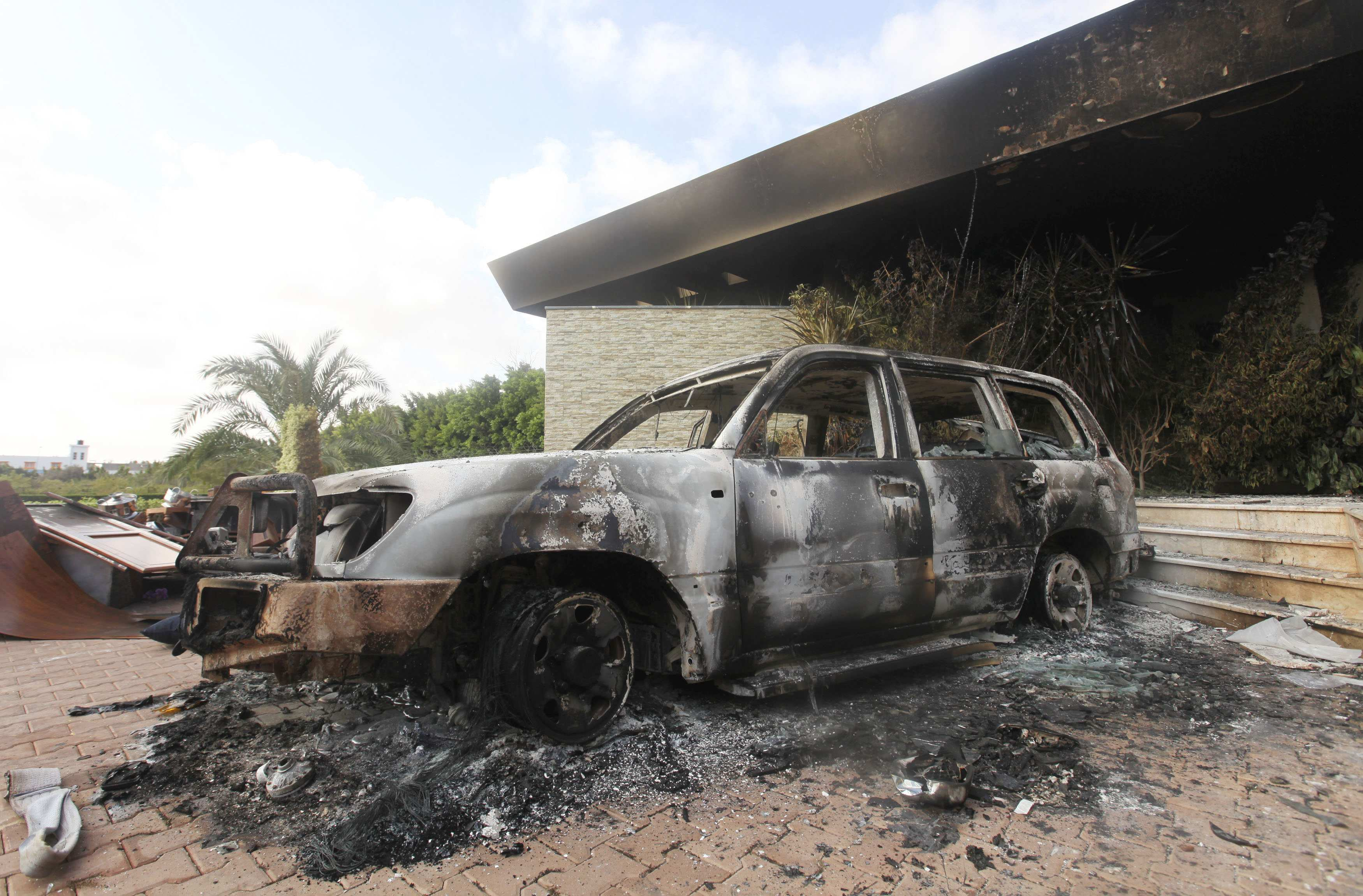 A burnt car is seen parked outside the U.S. Consulate in Benghazi  last week. (Esam Al-Fetori/Reuters)