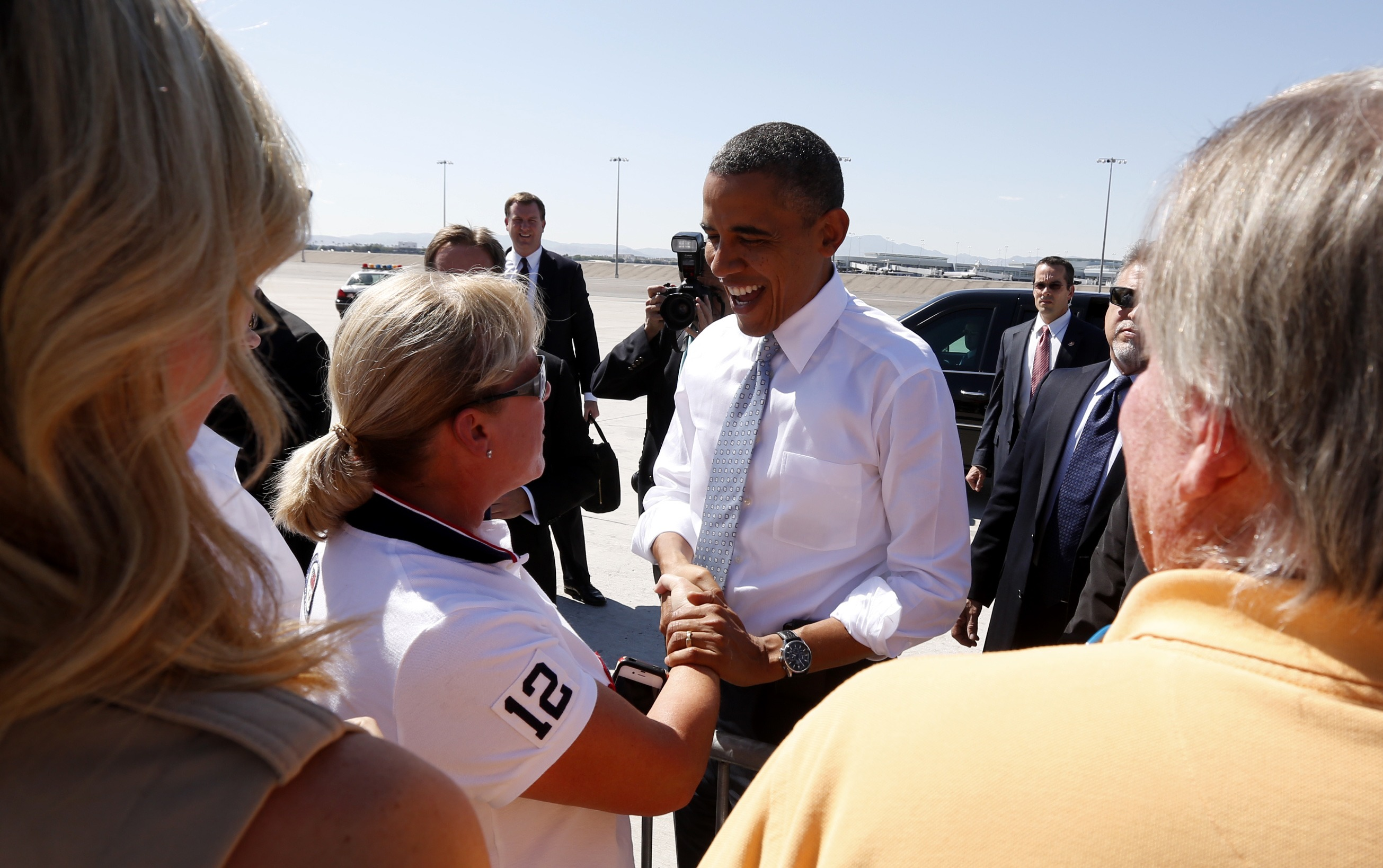 President Barack Obama greets supporters upon his arrival in Las Vegas, Nevada (Kevin Lamarque/Reuters)