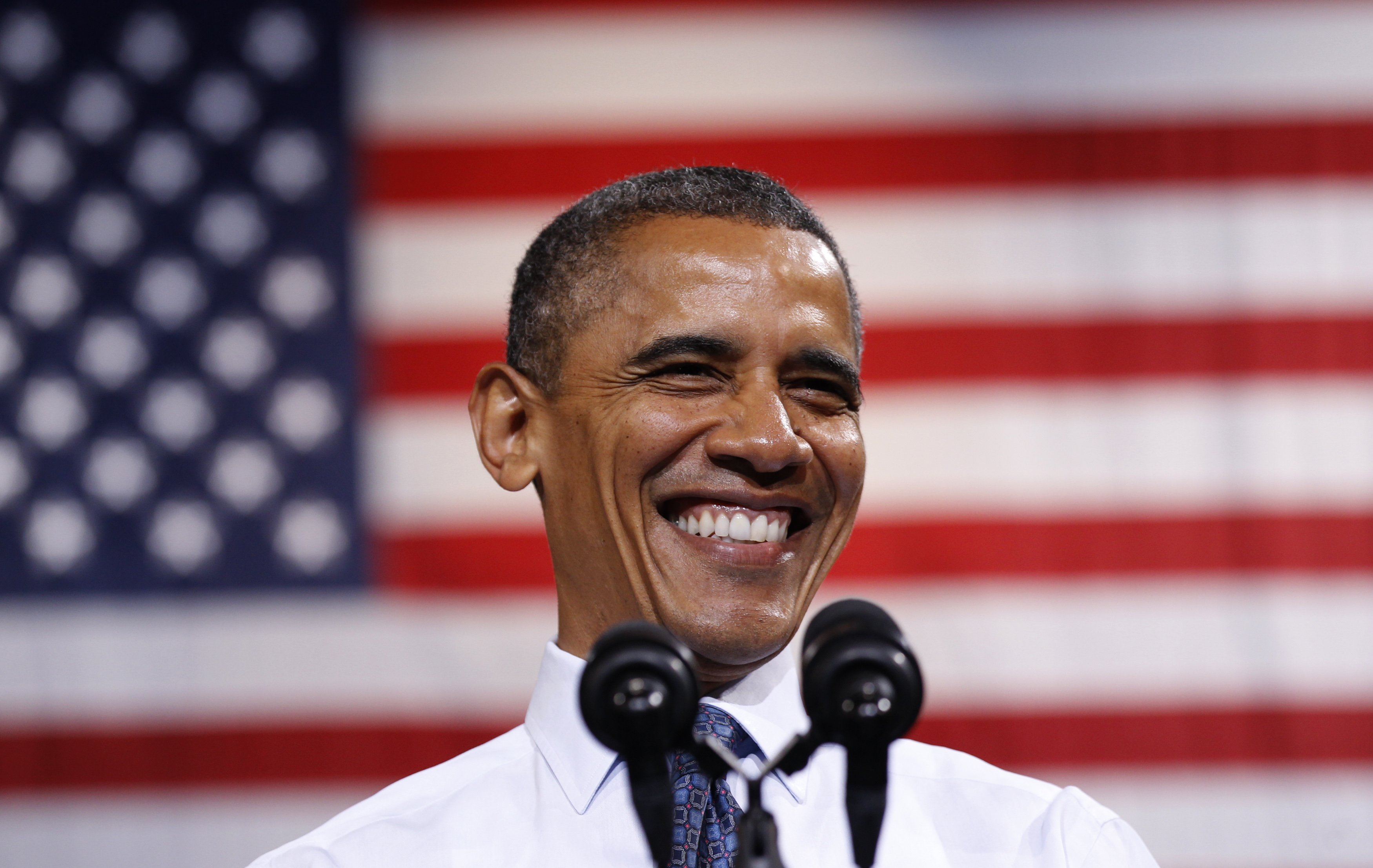 President Barack Obama smiles as he speaks during a campaign rally in Fairfax, Va. (Kevin Lamarque/Reuters)