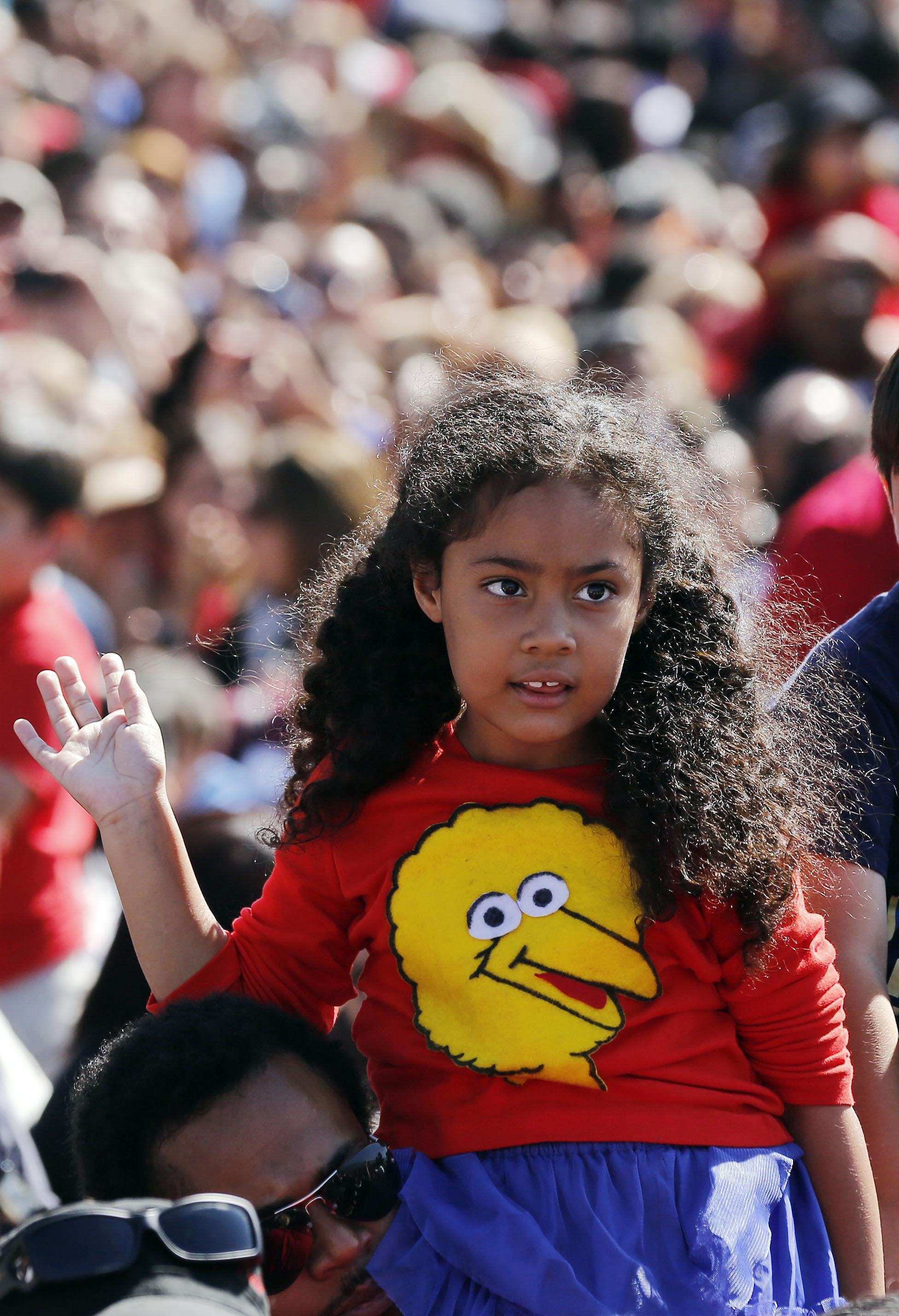 A girl wearing a Big Bird sweater waves at President Barack Obama at the Cesar E. Chavez National Monument in Keene, Calif. (Larry Downing/Reuters)