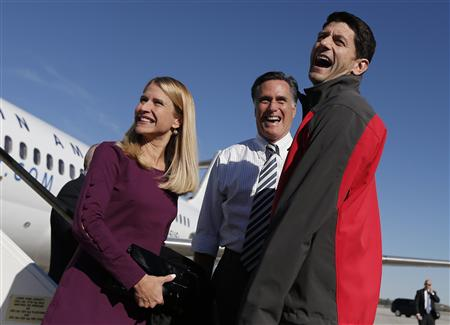 GOP challenger Mitt Romney laughs with running mate Paul Ryan and his wife Janna after arriving in Columbus, Ohio, October 12, 2012. (Shannon Stapleton/Reuters)