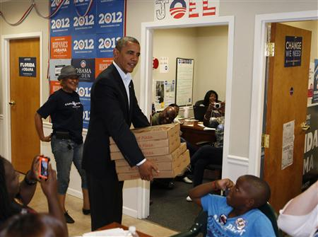 President Barack Obama delivers pizzas to campaign volunteers in Orlando