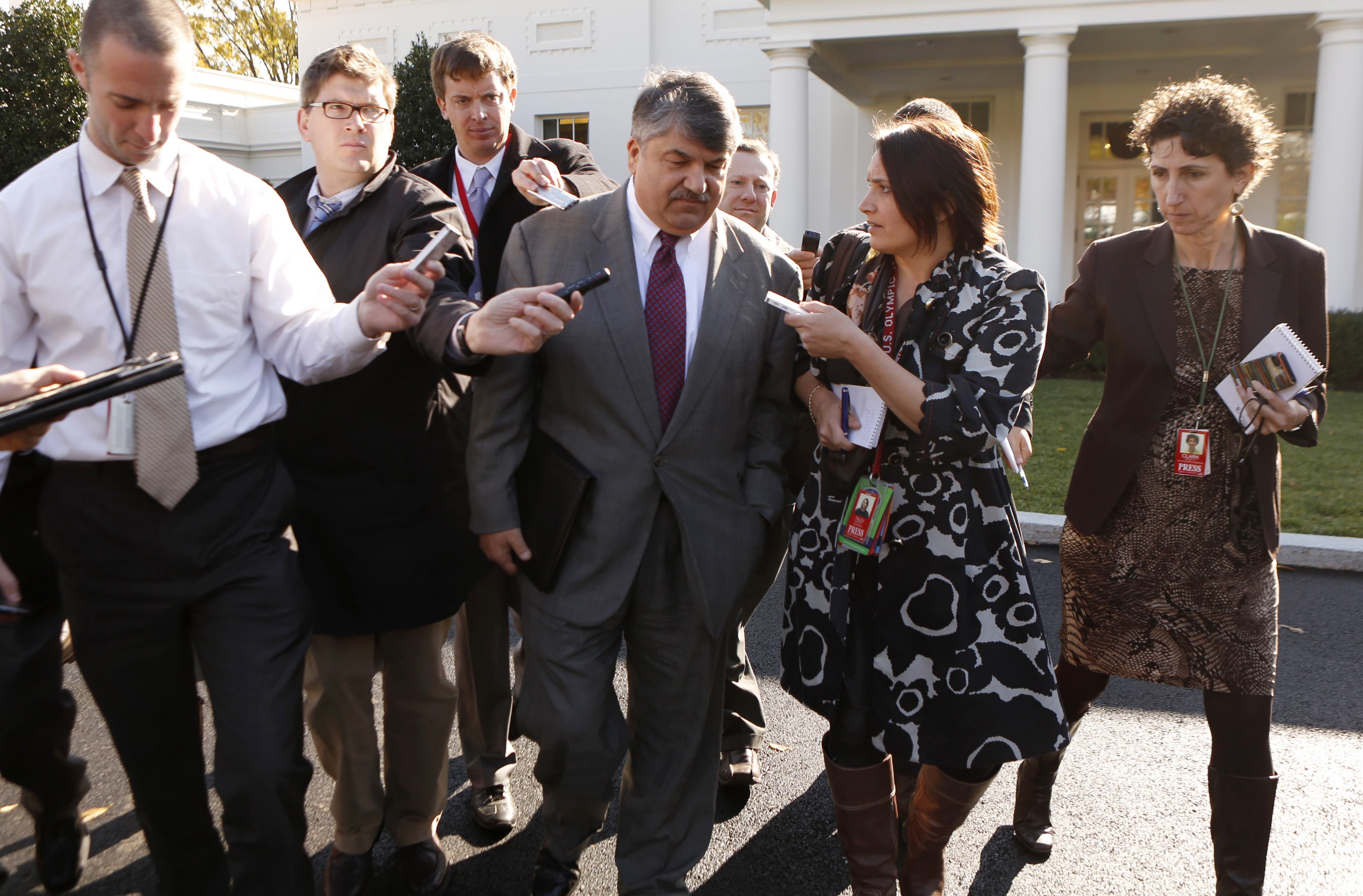 AFL-CIO President Richard Trumka is trailed by reporters as he departs the White House. (Kevin Lamarque/Reuters)