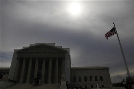 The sun shines through cloud cover above the U.S. Supreme Court building in Washington, June 13, 2013. The U.S. Supreme Court on Thursday issued a mixed ruling in a case concerning patents held by Myriad Genetics Inc over the closely watched issue of whether human genes can be patented. (Jonathan Ernst/Reuters)