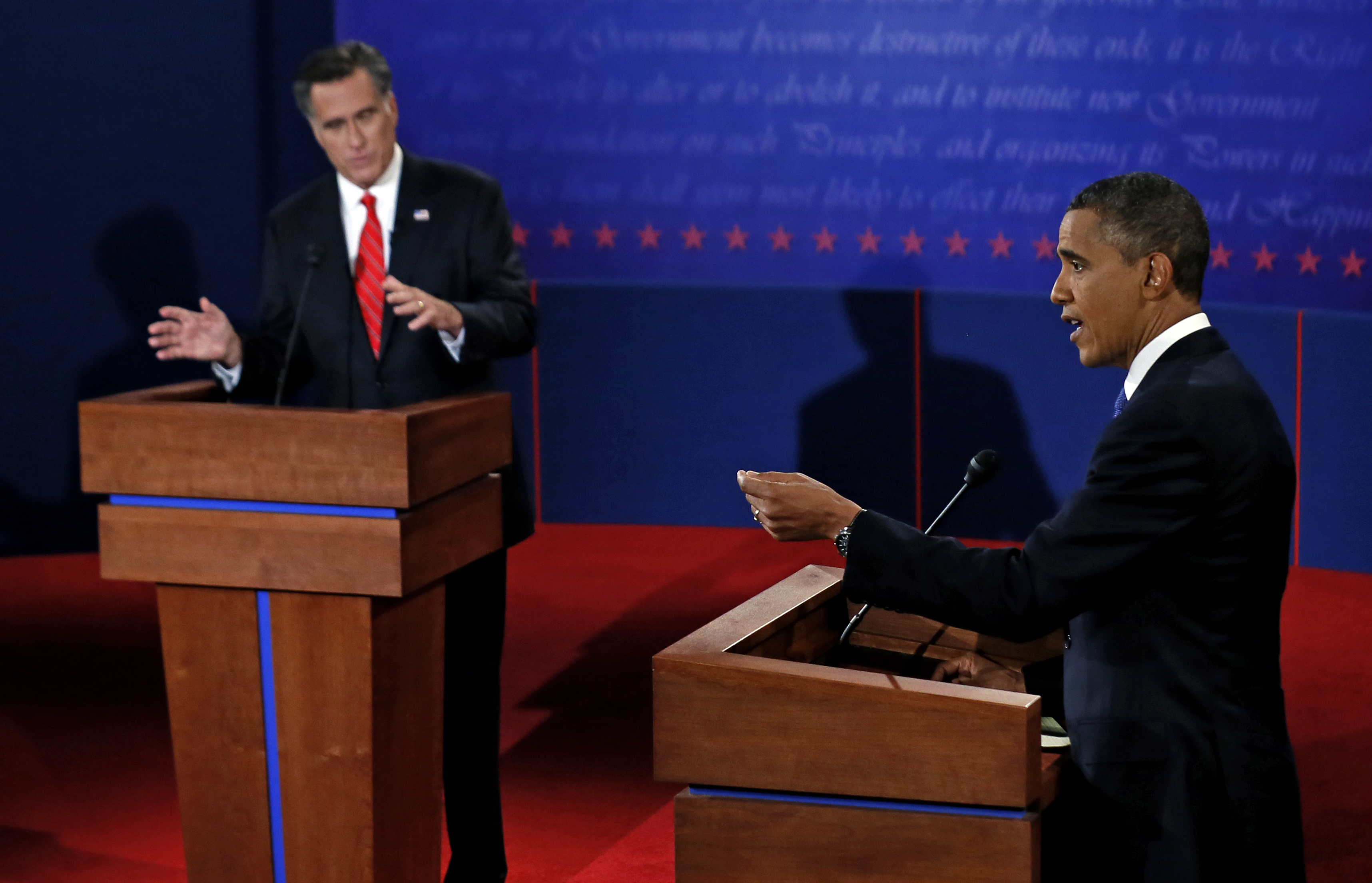 President Barack Obama and Republican presidential nominee Mitt Romney participate in their first presidential debate (Rick Wilking/AP)