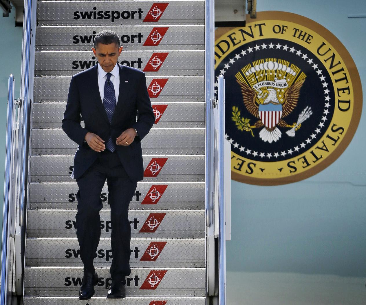 President Barack Obama steps off Air Force One upon his arrival Monday in New York. (Pablo Martinez Monsivais/AP)