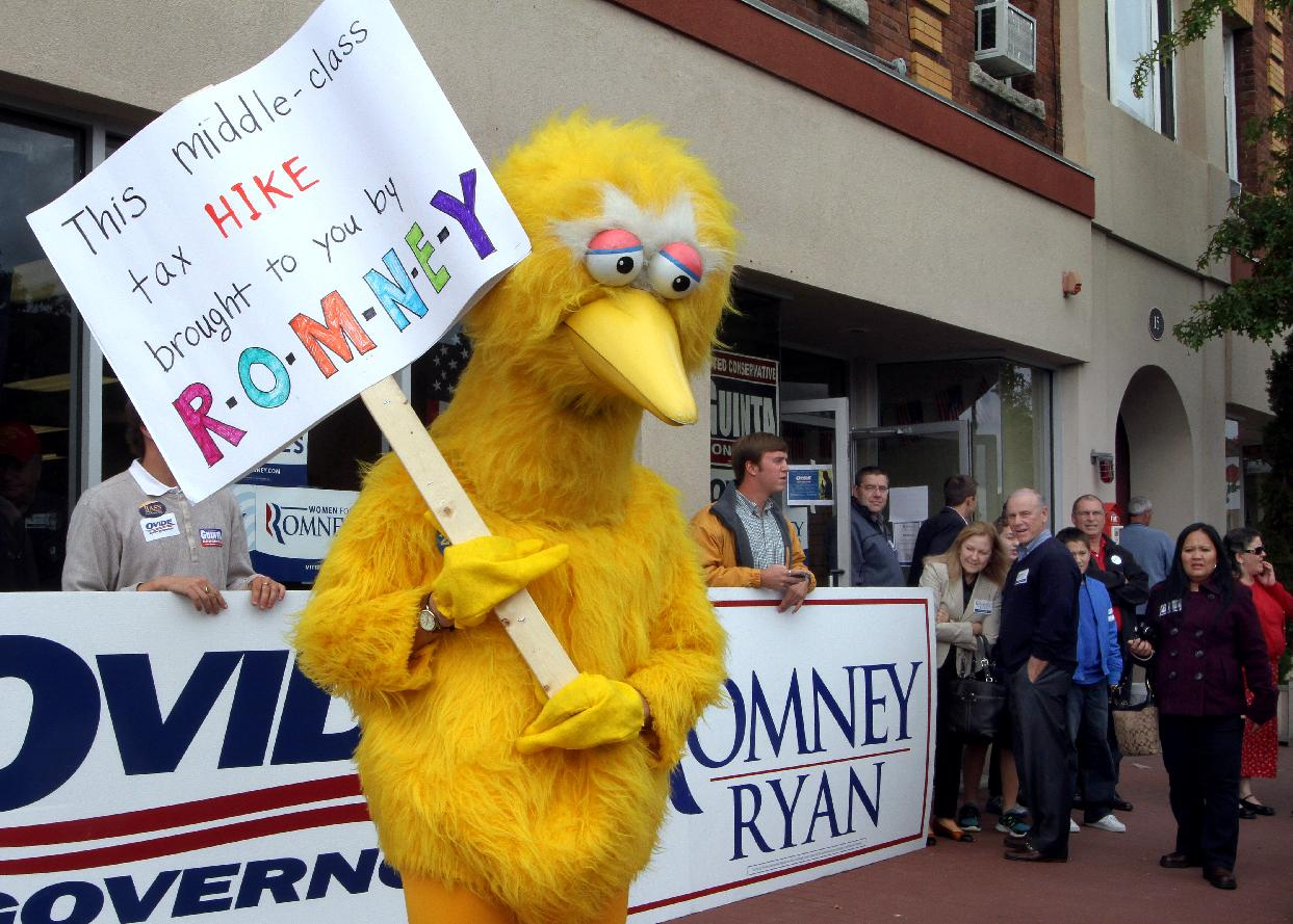 A person dressed up as Big Bird holds a sign against Republican presidential candidate, former Massachusetts Gov. Mitt Romney outside the Romney HQ in Derry, N.H. (Jim Cole/AP)