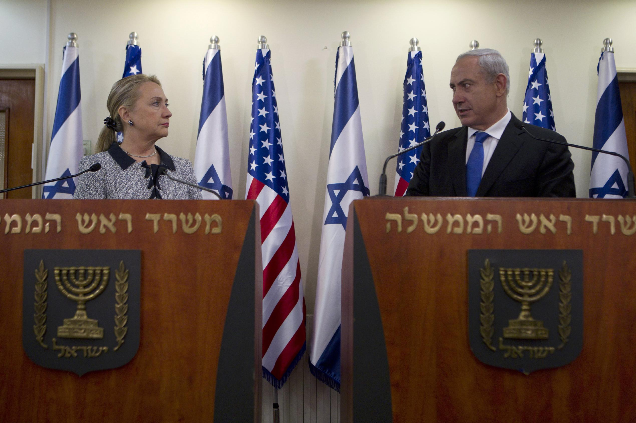 U.S. Secretary of State Hillary Rodham Clinton and Israel's Prime Minister Benjamin Netanyahu deliver joint statements in Jerusalem. (Baz Ratner/Pool via AP)