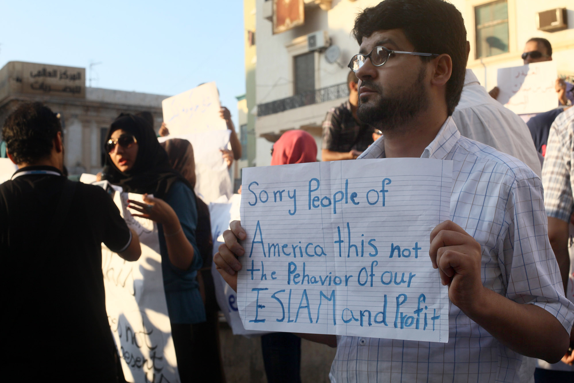 A Libyan man holds a placard in English during a demonstration Wednesday against the attack on the U.S. Consulate that killed four Americans, including the ambassador, in Benghazi, Libya. (Ibrahim Alaguri/AP)