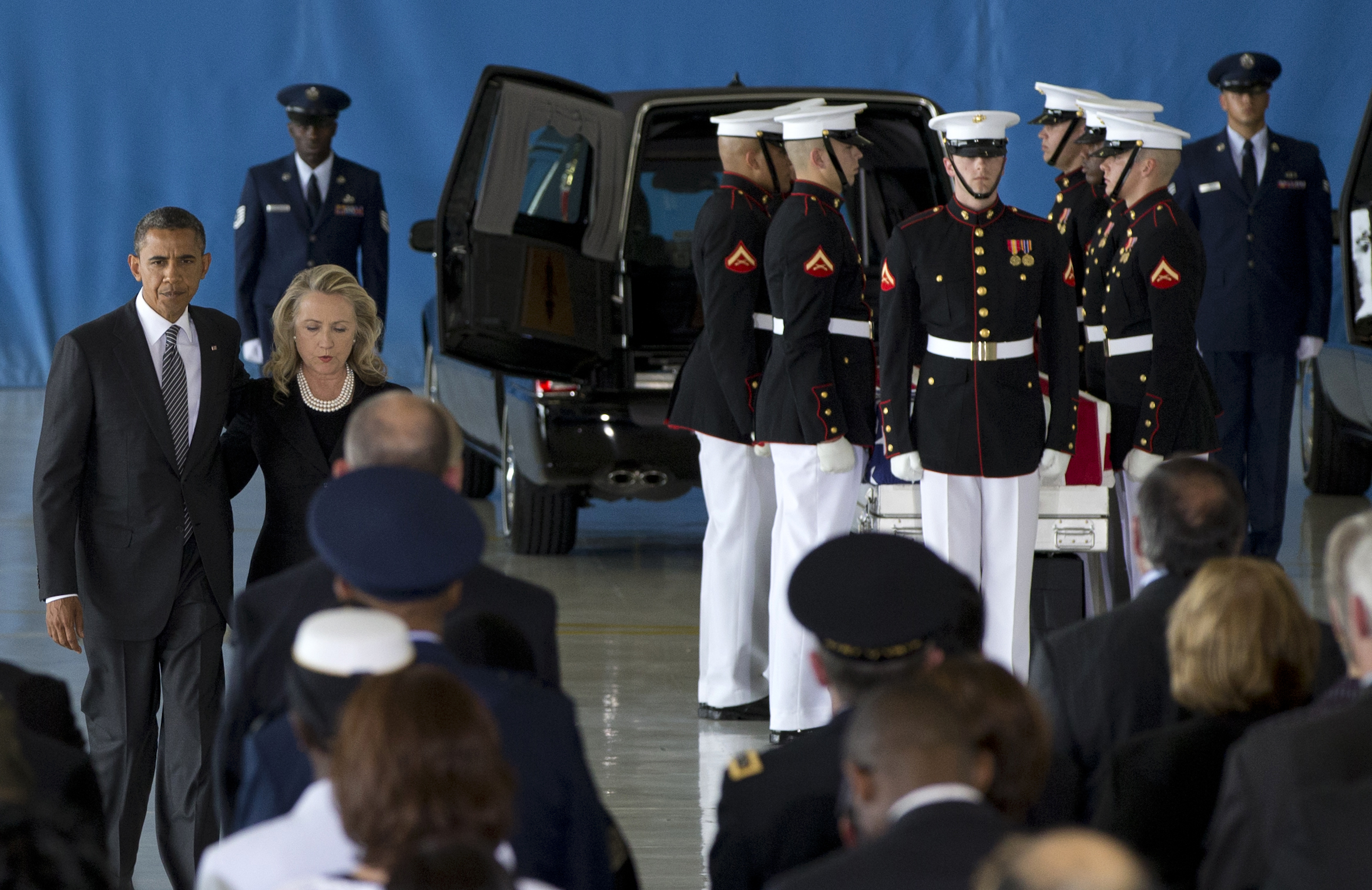 President Barack Obama and Secretary of State Hillary Rodham Clinton walk back to their seats during the Transfer of Remains Ceremony. (Carolyn Kaster/AP)
