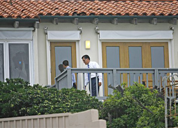 Romney enters his La Jolla, Calif. beachouse in 2008 (Denis Poroy/AP)