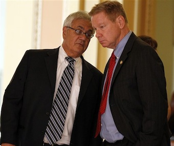 Rep. Barney Frank, left, talks with former Rep. Tom Davis in 2010. (Alex Brandon/AP)