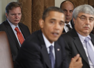 In this picture from November 2010, then-Deputy White House Chief of Staff Jim Messina (left) and Assistant to the President for Legislative Affairs Phil Schiliro, right, listen as President Barack Obama speaks to reporters. To the right of Obama is Pete Rouse, then White House Chief of Staff. (Charles Dharapak/AP)