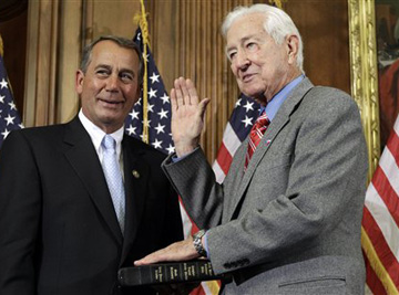 Oldest House member Ralph Hall, right, being sworn in by John Boehner. (AP/Charles Dharapak)