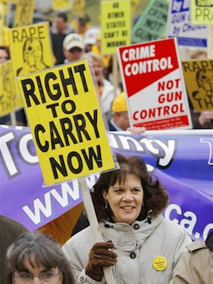 Gun rights supporters rally in Illinois in Mar. 2011 (Seth Perlman/AP)
