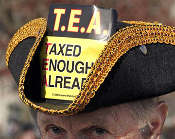 A tea partier listens to Tim Pawlenty at a Boston, Mass. rally (Winslow Townson/AP)