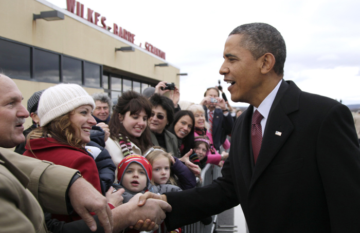 Obama greets a crowd at Wilkes Barre/Scranton International Airport (Carolyn Kaster/AP)