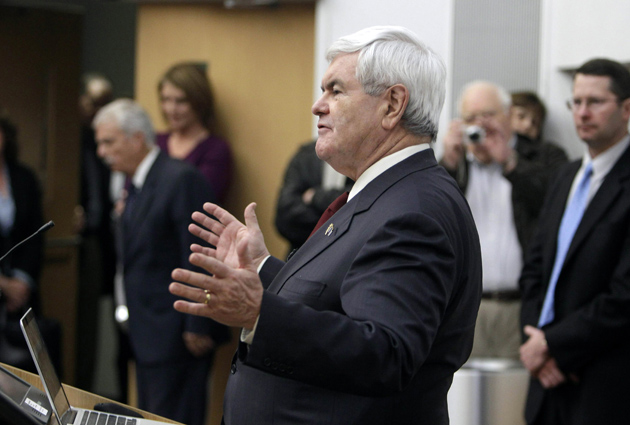 Gingrich gestures during his speech on brain science Dec. 14 (Charlie Neibergall/AP)