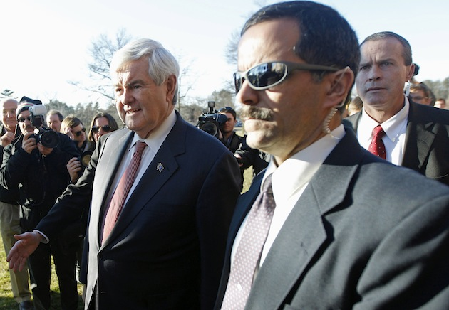 Newt Gingrich is escorted by his security team in Nashua, N.H. in January. (Charles Krupa/AP))