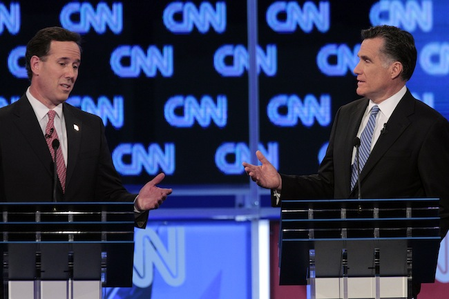Santorum and Romney traded barbs over immigration last night. (AP)