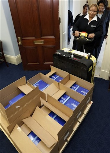 Copies of the White House budget are delivered to the House Monday. (J. Scott Applewhite/AP)