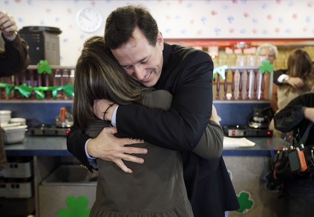 Rick Santorum hugs his wife Karen, before greeting diners in Kentwood, Mich. (Paul Sancya/AP)