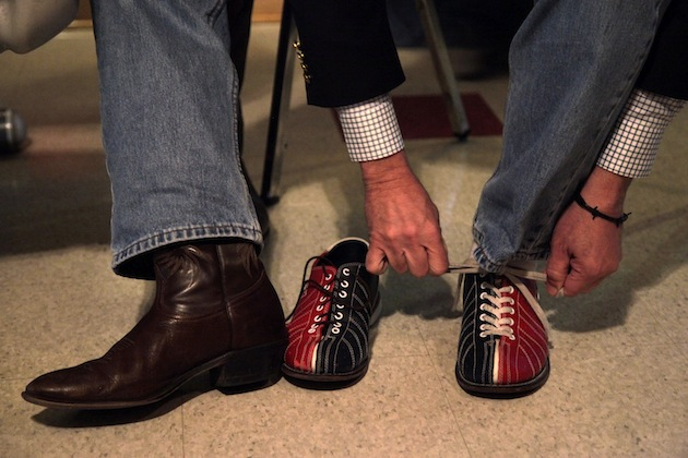 Rick Santorum changes into bowling shoes in La Crosse, Wis. (Jae C. Hong/AP)